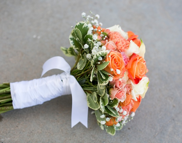 bridal bouquet orange, pink, and white