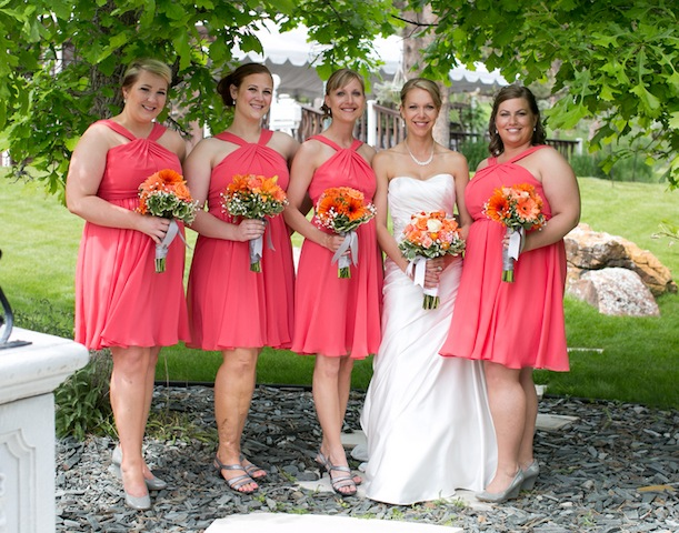 bride with bridesmaids in short hot pink bridesmaids dresses