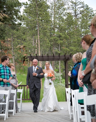 father of the bride and bride at outdoor wedding