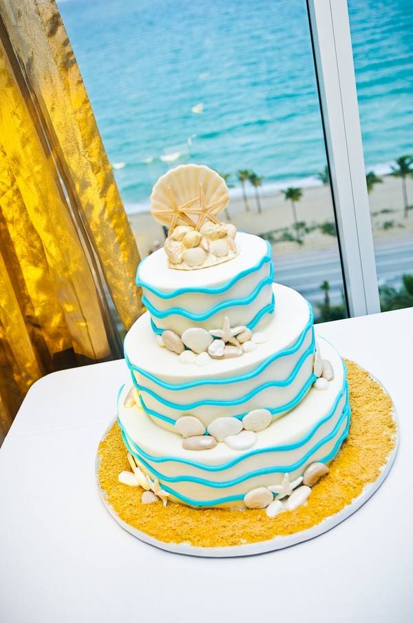 nautical wedding cake with shells