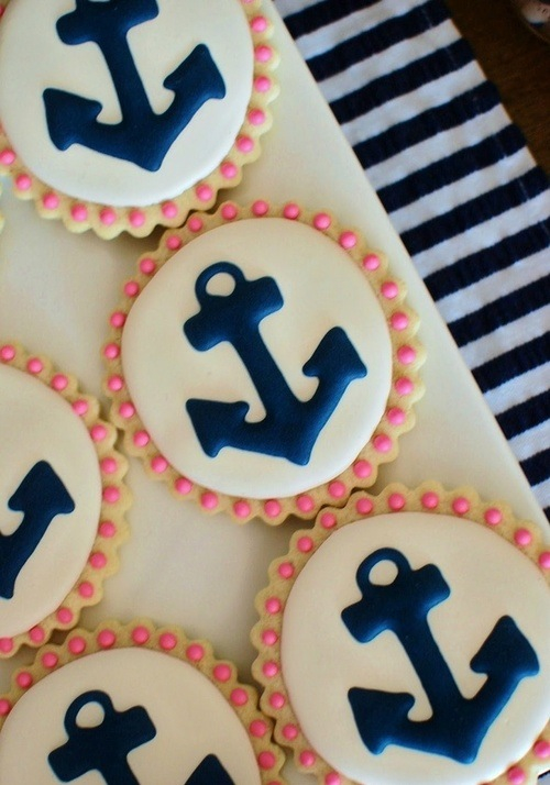 White cookies with blue anchors