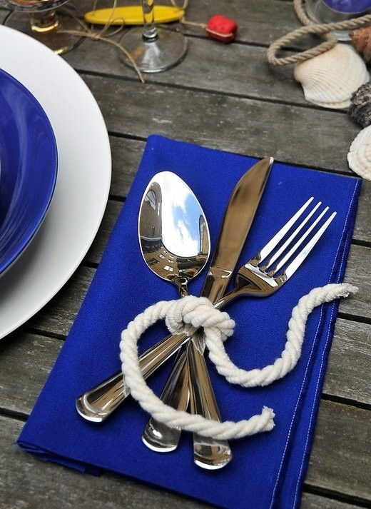 Blue napkin with white sailor rope tying silverware