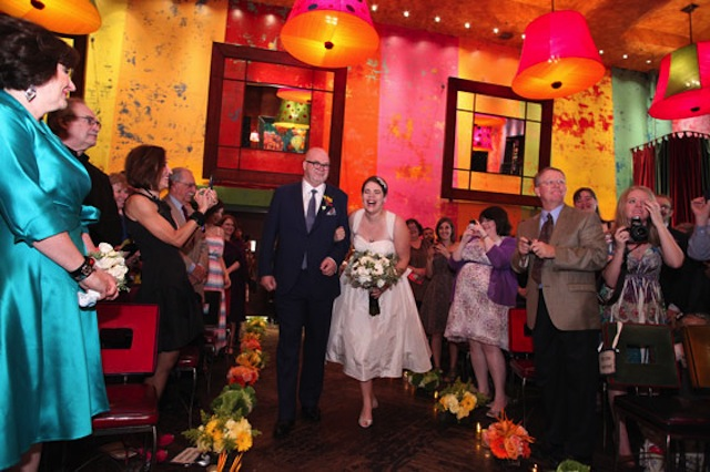 colorful aisle at wedding, bride and groom walk down