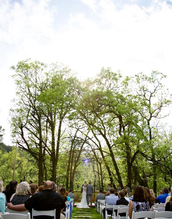outdoor wedding site under trees