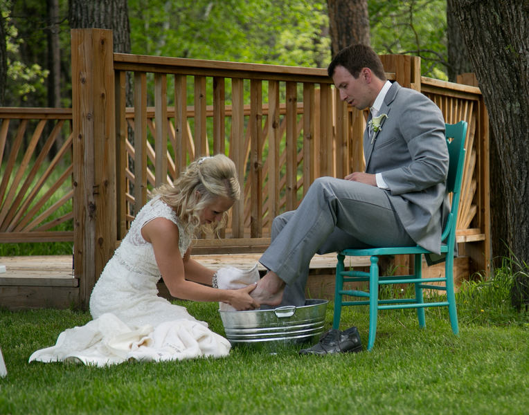 bride washes the feet of her groom