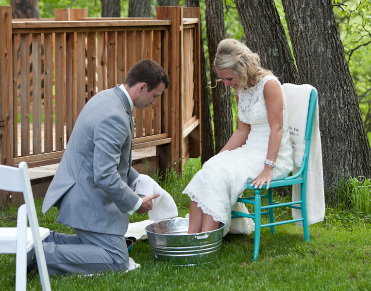 groom washing the feet of the bride for Christian wedding