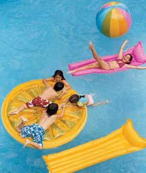 kids on pool floats