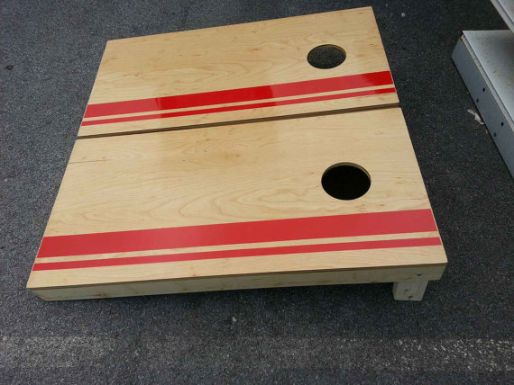 Handmade corn hole game boards with red stripes