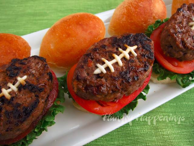Football burgers with lettuce and tomato