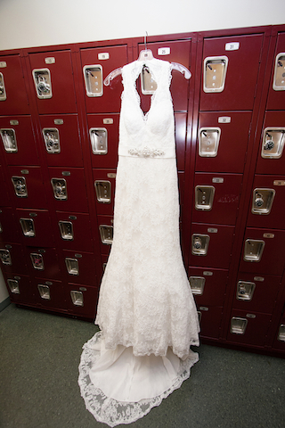 wedding dress on red lockers