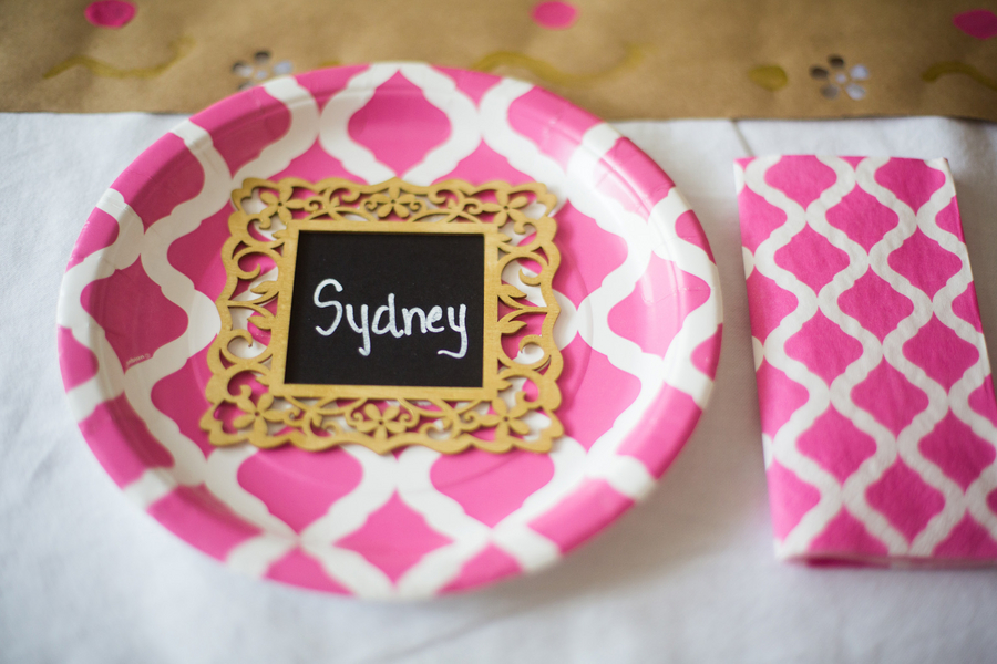 Pink, white and gold place setting with name card