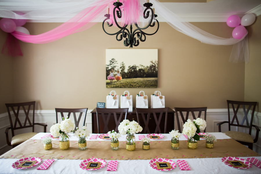 Pink and gold table setting for glamping party
