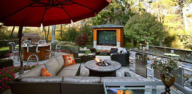 outdoor seating with fire place and television