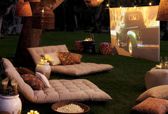 lounge chairs outside with movie screen