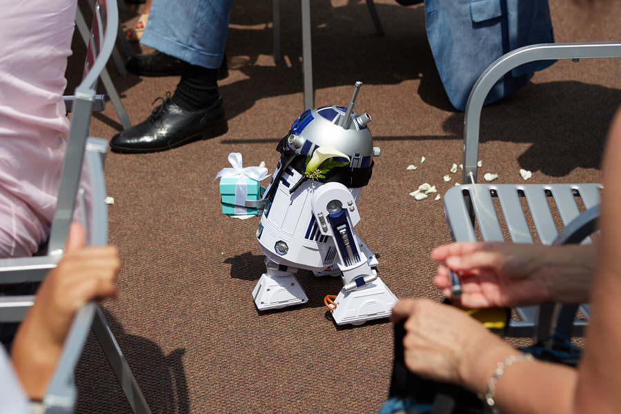 R2D2 robot ring bearer at Star Wars themed wedding