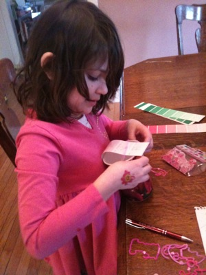 girl using paint cards for place cards