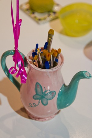 ceramic tea pot holding paint brushes