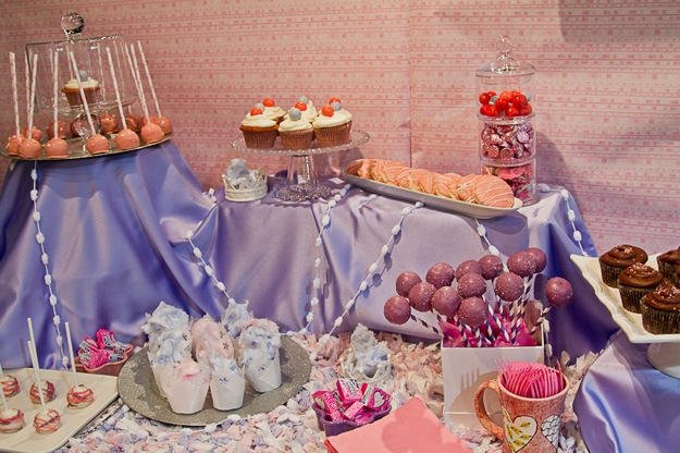 purple sweet table with cake pops and other sweets