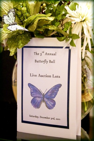 butterfly themed announcement for auction