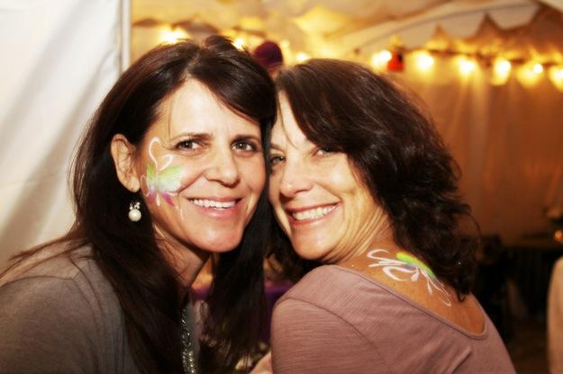 women with butterflies on face