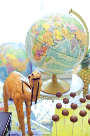 globe and camel stand over cake pops