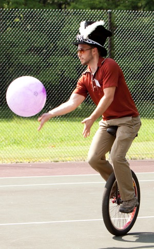 juggling unicyclist