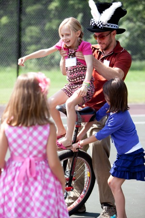 child learns to ride unicycle