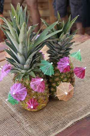 tropical drinks with pineapples and umbrellas