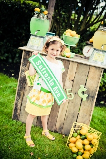 homemade lemonade stand with birthday party girl