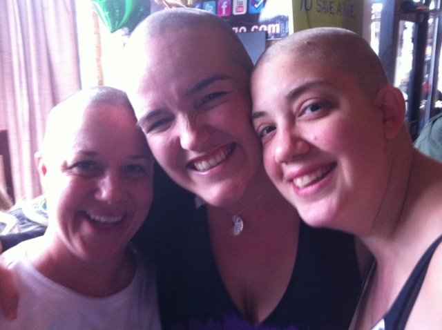 women with shaved heads for cancer research