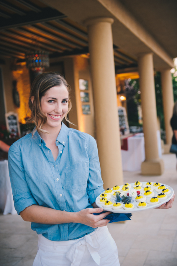 Event waitstaff serve food to guests