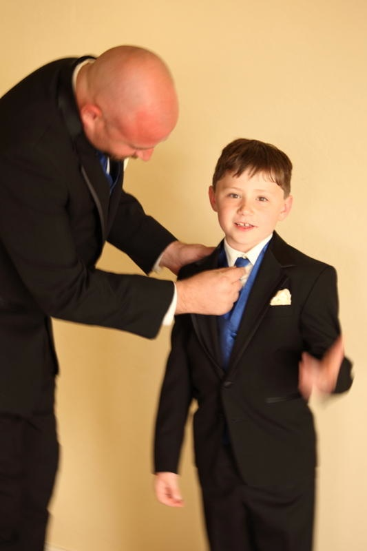 ring bearer boy in blue tie at wedding