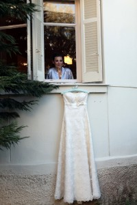 bride in window looking at strapless dress