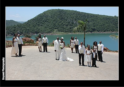 outdoor wedding with bridal party in white