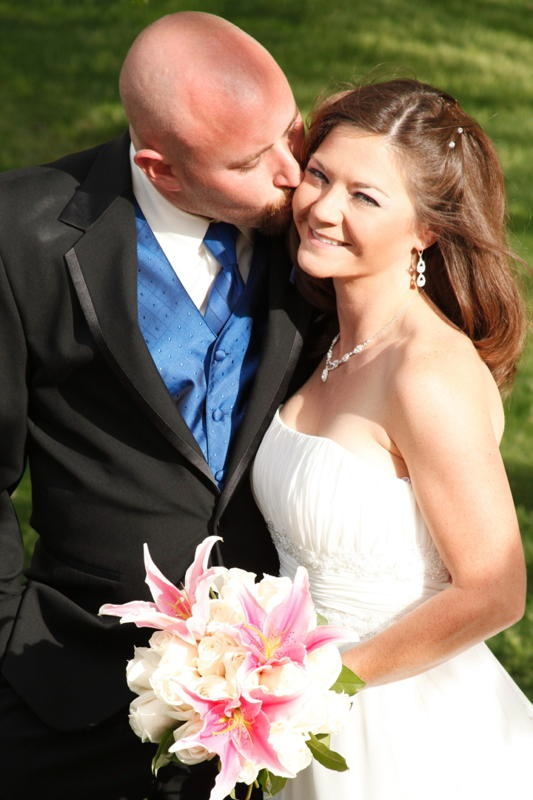 brunette bride and groom in blue vest and tie