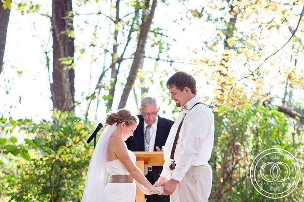outdoor wedding with bride in white strapless dress with brown sash