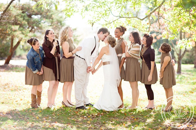 bride and bridesmaids in various brown dresses