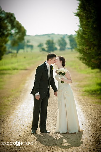 outdoor bride and groom kiss after wedding