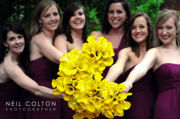 bright yellow flowers and bridesmaids in maroon dresses