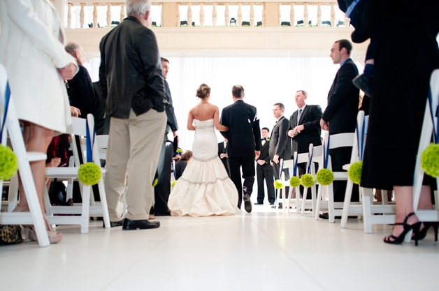 wedding chairs with green pom poms
