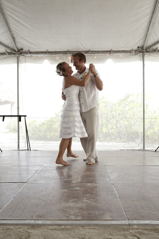 bride and groom dance barefoot in tent