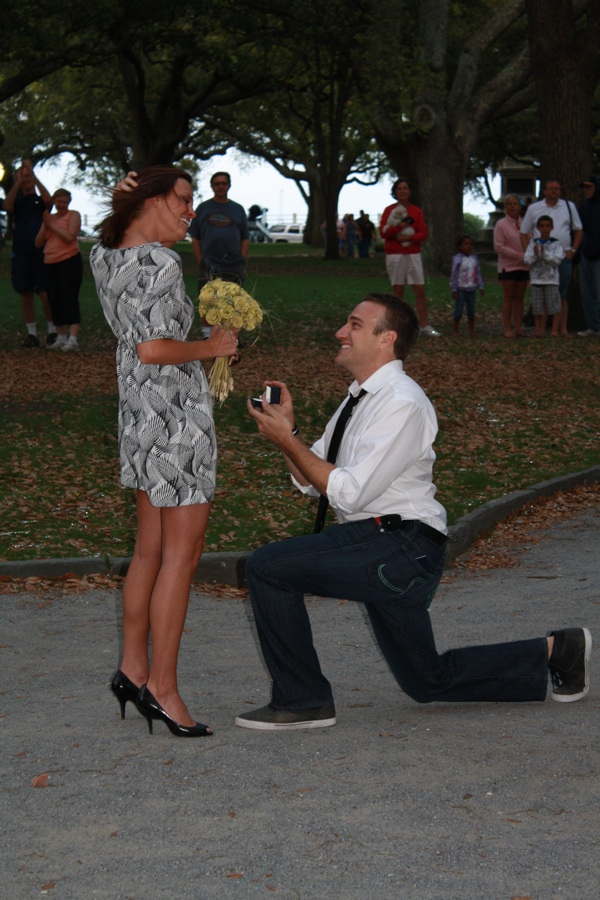man proposing on one knee