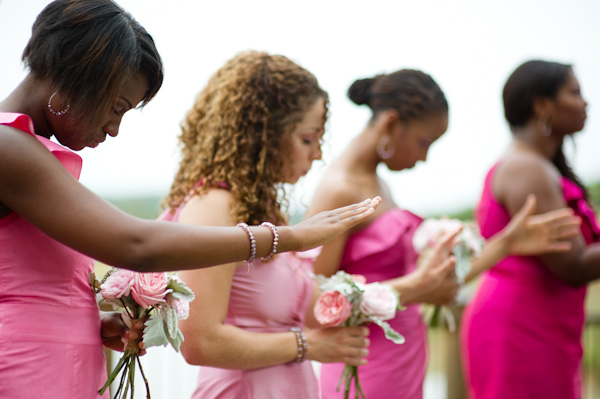 bridesmaids in pink praying
