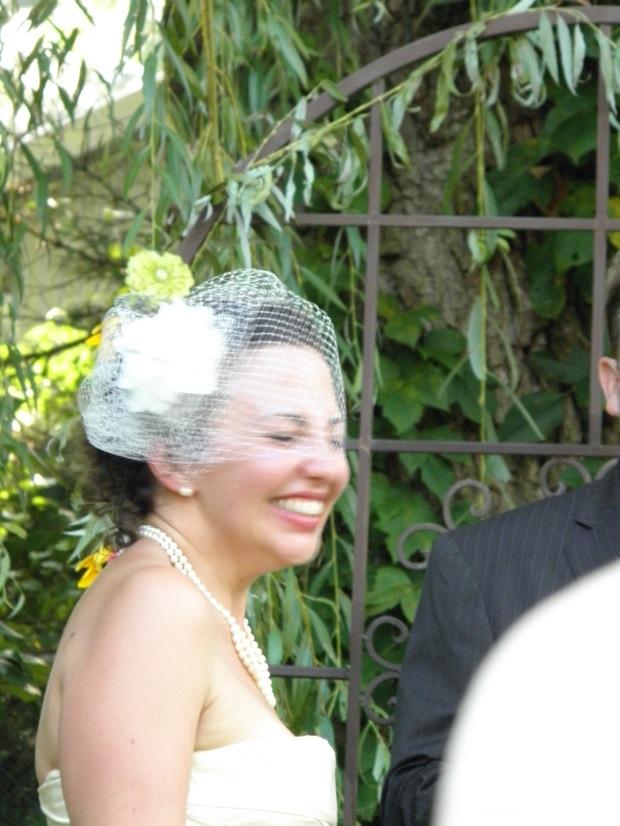 outdoor wedding with bride smiling
