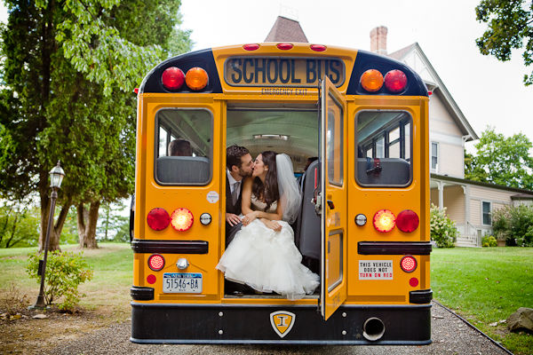 bride and groom on school bus