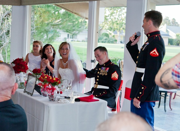 best man in military uniform gives toast at wedding