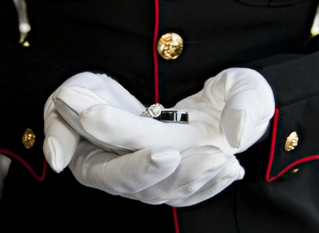 platinum wedding rings held by marine