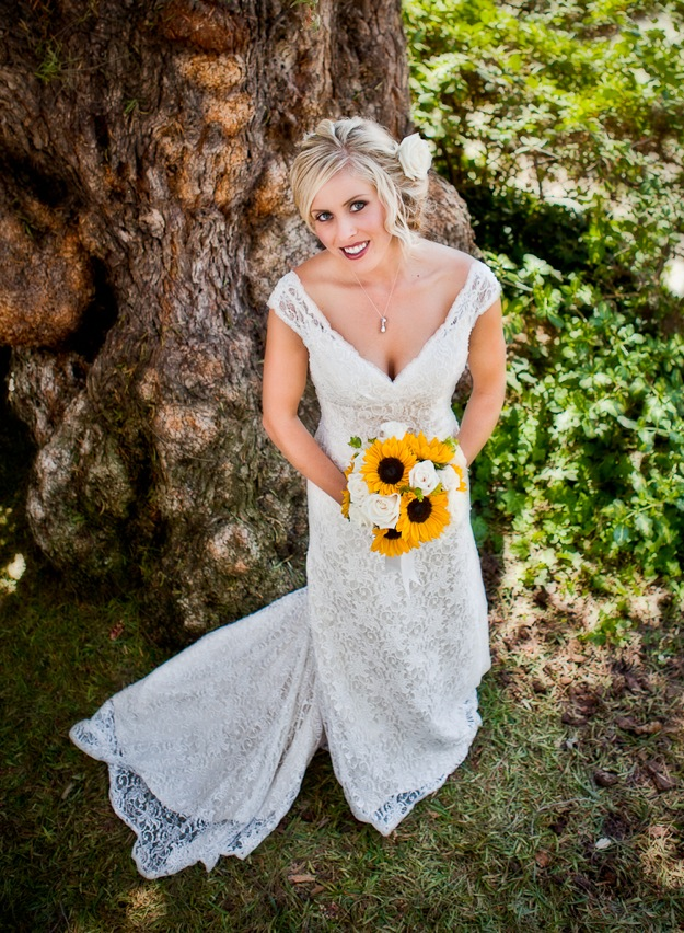 vintage white wedding dress with sunflower bouquet