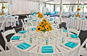 wedding tent with tables with yellow and blue touches