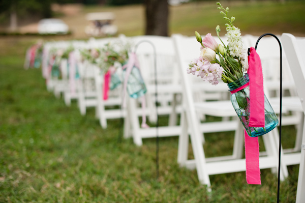 outdoor wedding seating with pink accents and flowers